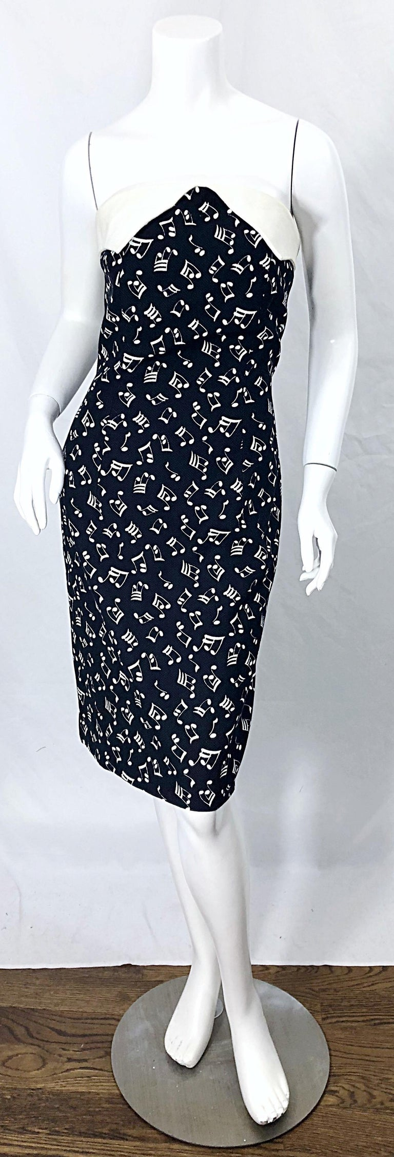 Rare vintage 80s PATRICK KELLY novelty music print black and white strapless dress ! Features a black cotton fabric with printed white music notes throughout. White poplin cotton trim around the bodice. Hidden zipper up the back with hook-and-eye