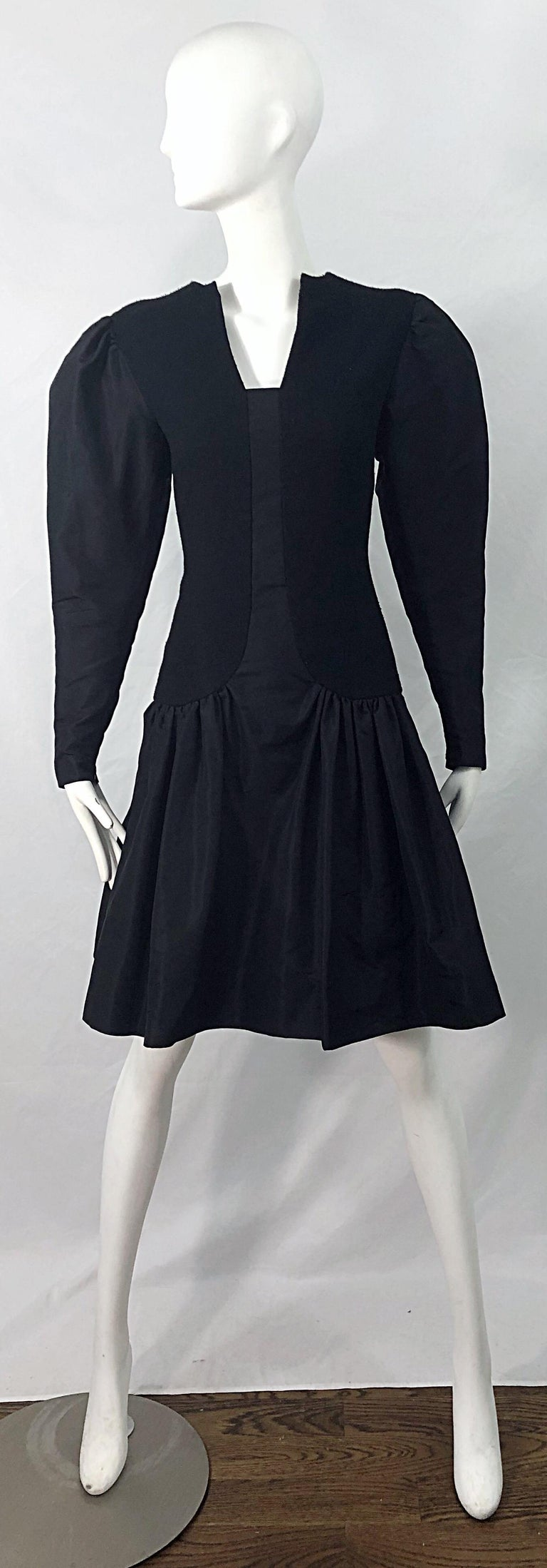 Avant Garde 1980s PAULINE TRIGERE black wool and silk taffeta dress ! Features a tailored wool bodice with taffeta panel down the center. Full taffeta puff sleeves add just the right amount of volume. Taffeta flared skirt. Hidden zipper up the back
