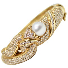 1980s Pearl and Diamond Hinged 18 Karat Yellow Gold Bangle Bracelet