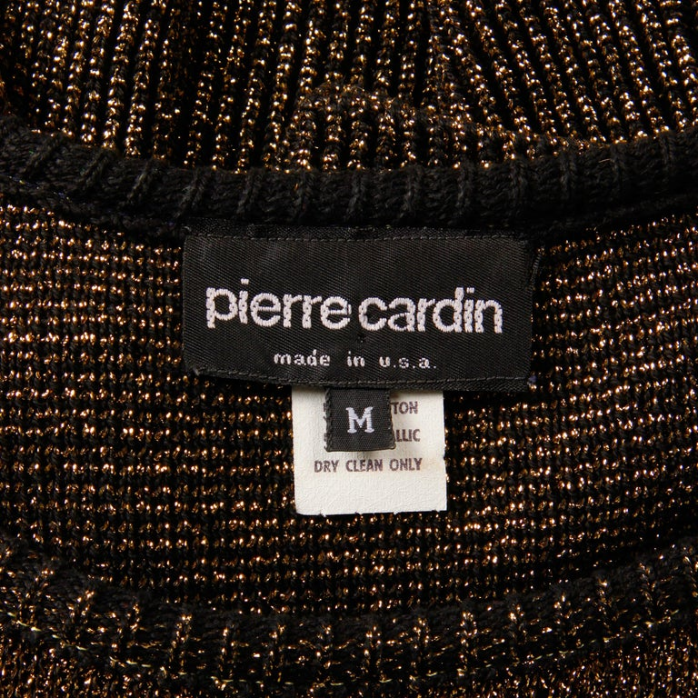 Vintage 1980s metallic gold sweater by Pierre Cardin. Unlined with no closure (pulls on over the head). 50% cotton, 50% metallic. The marked size is medium, but this will also fit a modern size small. The bust measures 36-44