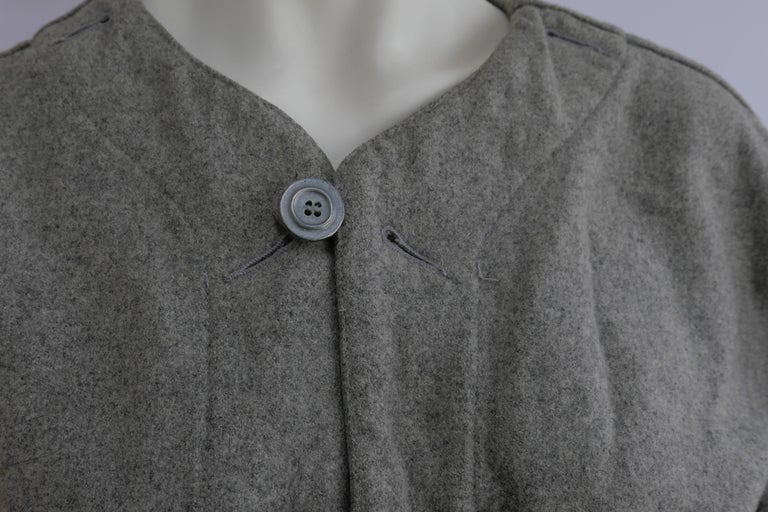 1980's Plantation Issey Miyake Jacket  Light grey Issey Miyake wool jacket with large buttons. The jacket shape is true to the 1980's large fit jacket style with loose sleeves. Plantation was originally founded by Issey Miyake in 1981. Total Length: