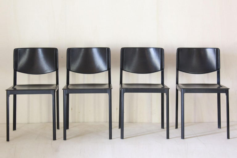 A 1980s Postmodern design dining chairs by Matteo Grassi designer. Set of four dining chairs made in leather and steel, Pure made in Italy design from the 1980s.  Elegant shaped leather chairs by Matteo Grassi with the bare metal frame. The leather'