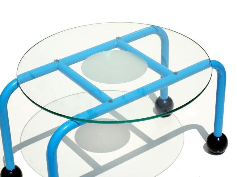 Enameled metal frame with wood feet Crystal top.