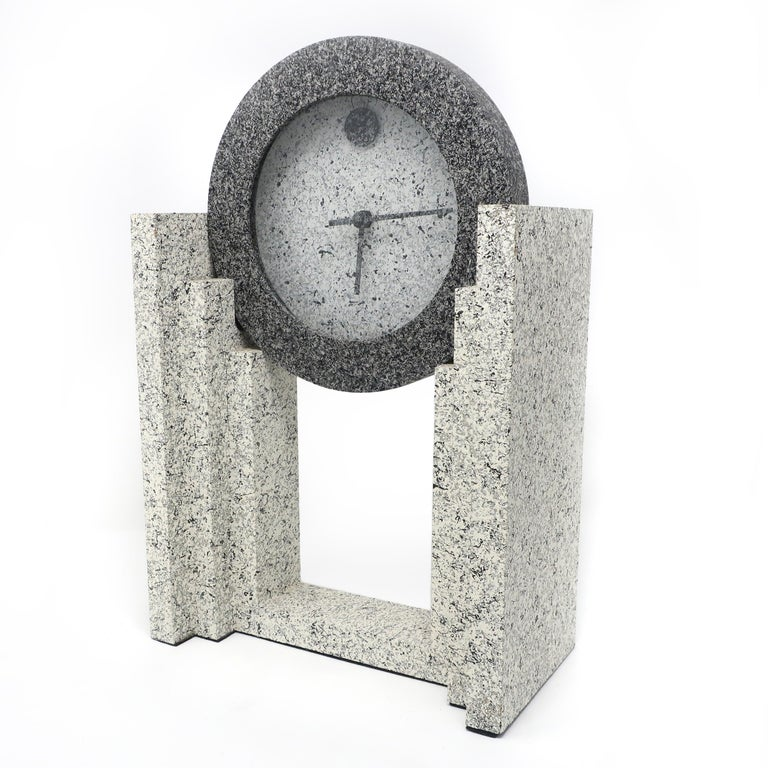 A vintage 1980s postmodern textured mantle clock by Empire Art Products in various shades of spelled gray. In very good vintage condition and works well.  Measures: 9.5