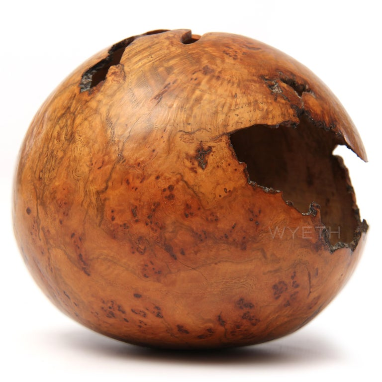 A delicate lathe turned sphere in red oak burl with natural occlusions. Signed