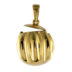 1980s Retro Secret 18 Karat Yellow Gold Pendant