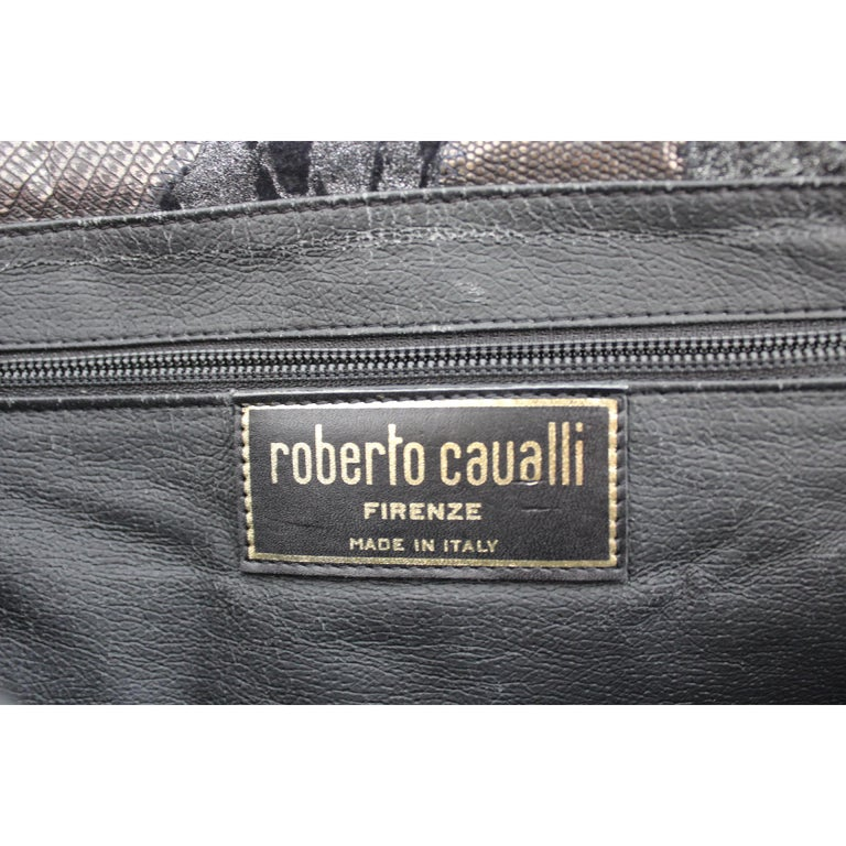 Roberto Cavalli vintage handbag, 100% leather, black and silver color, internal partitions with zip. 1980s. Made in Italy. Very good vintage condition, some imperfections have small signs of use.  Height: 25 cm  Width: 40 cm  Depth: 4 cm