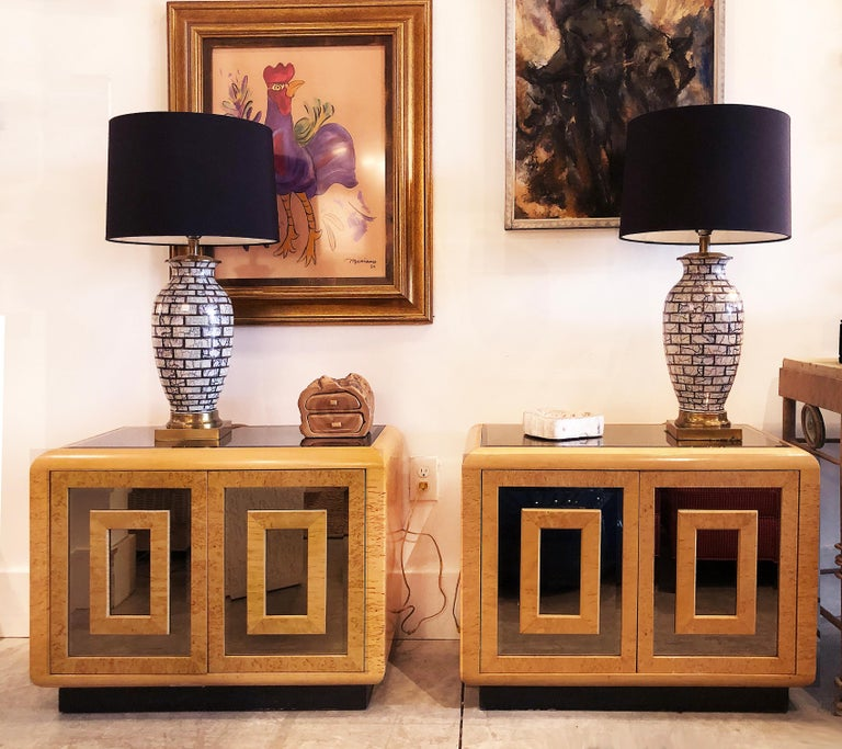 1980s RomWeber patterened maple mirror nightstands  Offered is a substantial pair of 1980s modern RomWeber Furniture Nightstands created with great patterned matched maple veneers with smoked beveled mirror doors and inset smoked mirrored tops. Each