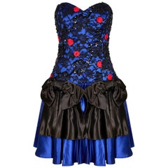 1980s Roots Blue Lace Cocktail Dress With Bow Detail and Structured Bodice