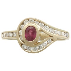 1980s Ruby and Diamond Yellow Gold Twist Ring