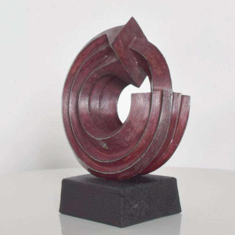 AMBIANIC presents:  Modern Abstract Sculpture by Sebastian the internationally known Sculptor born Enrique Carbajal González from Mexico.  Sculpture signed by SEBASTIAN 2003, 160/750. Patinated Bronze. Red Patina. Mounted on Teak Wood.  Dimensions: