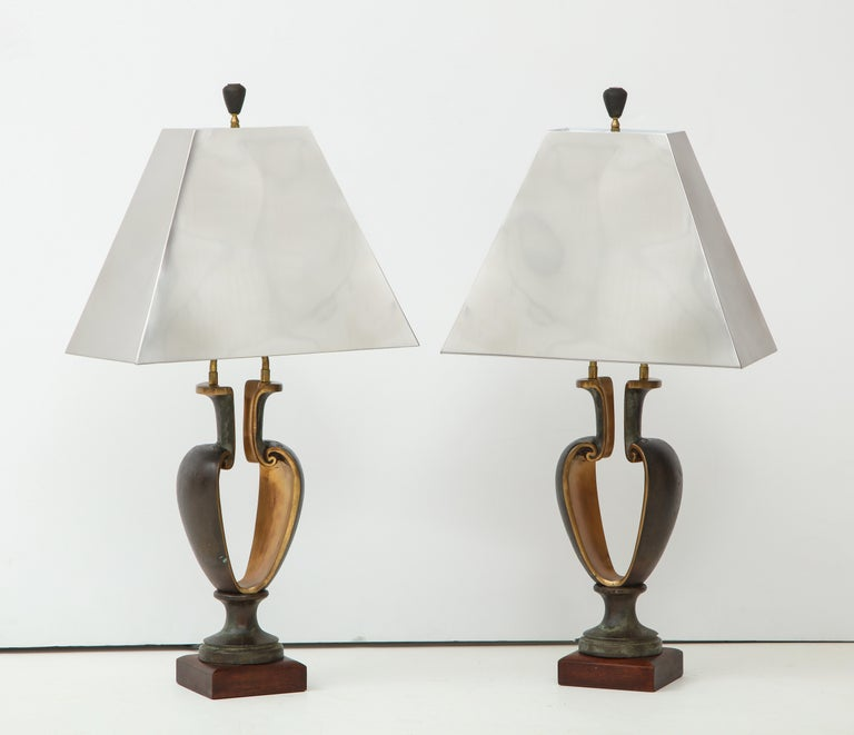Stunning pair of 1980s solid bronze Brutalist style table lamps with chrome shades. The lamps are well made and very heavy