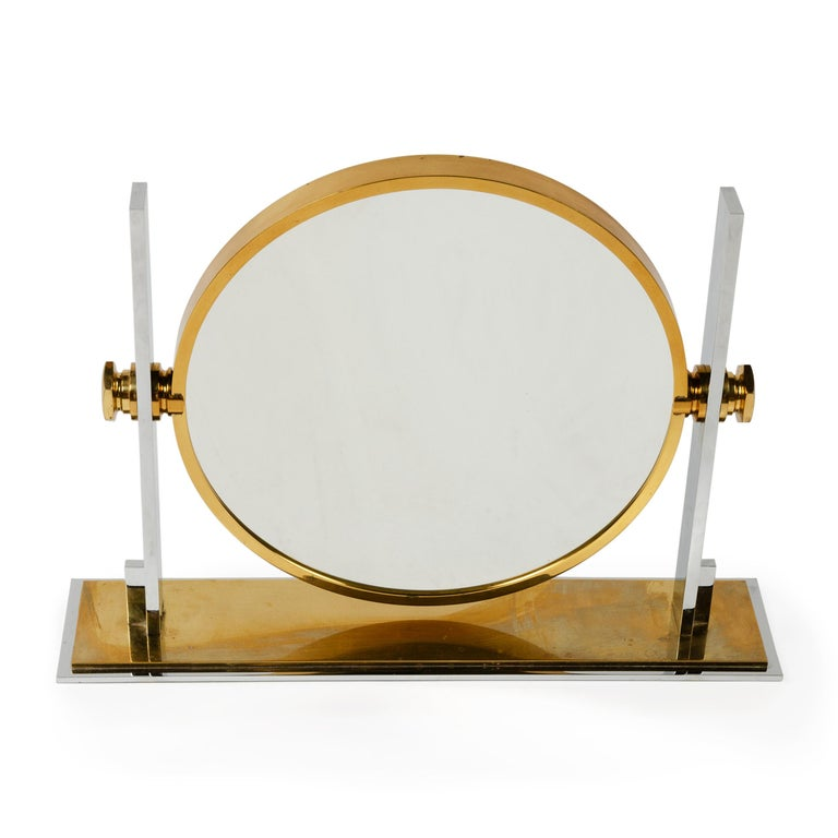 A solid brass and chrome-plated mirror that rotates to feature a 13.5
