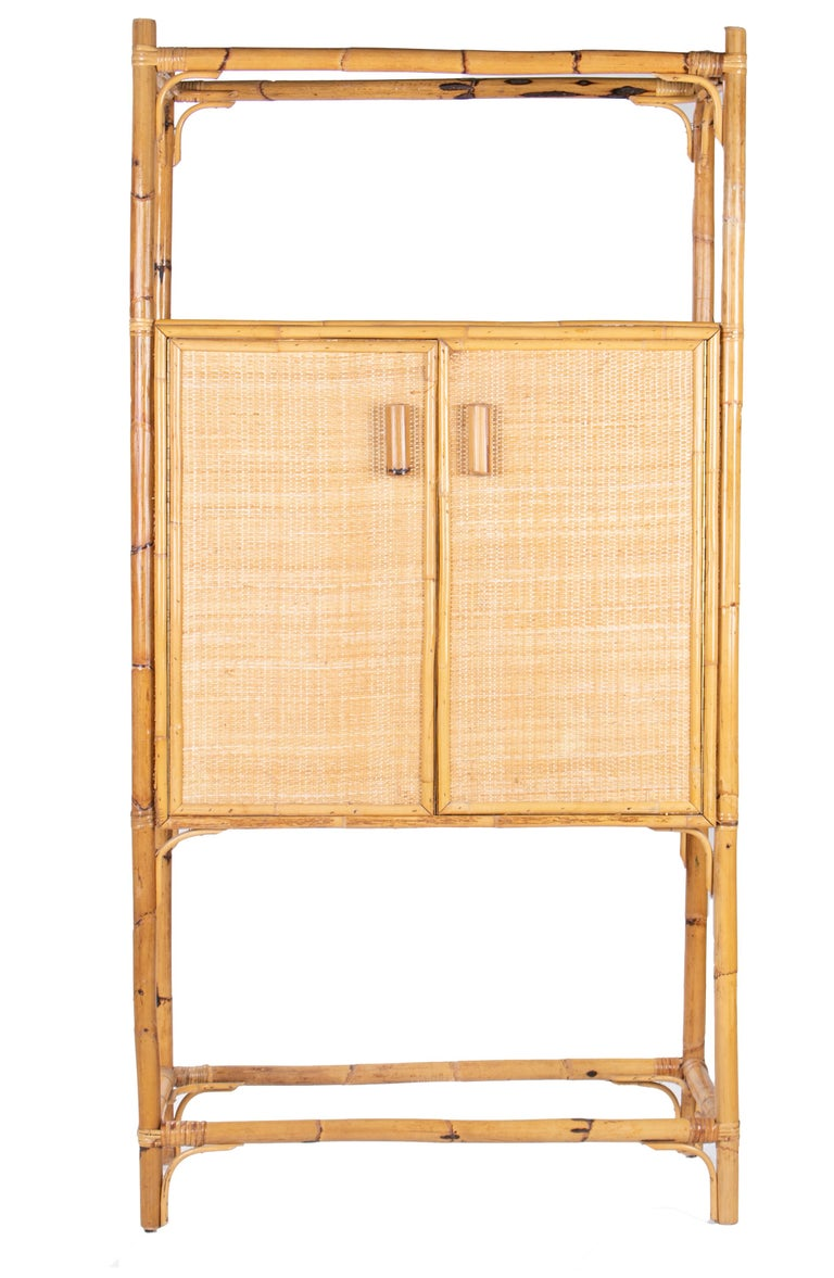 1980s Spanish bamboo two-door shelved bookcase.