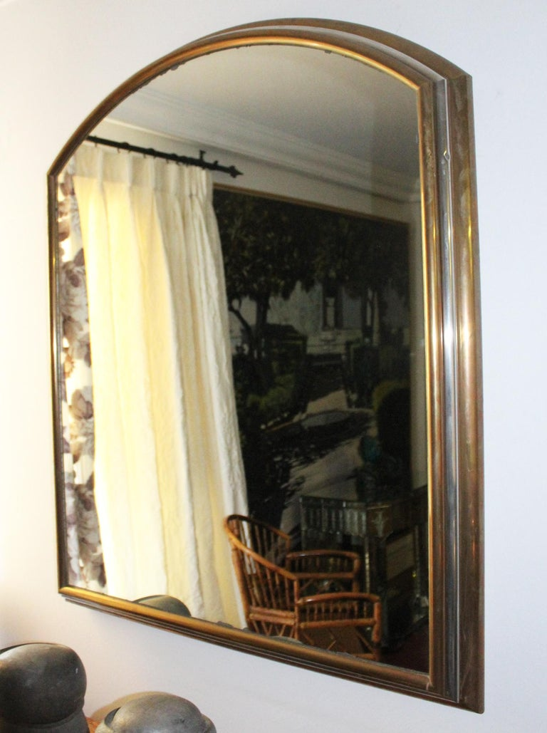 1980s Spanish metal mirror with two-tone brass frame.