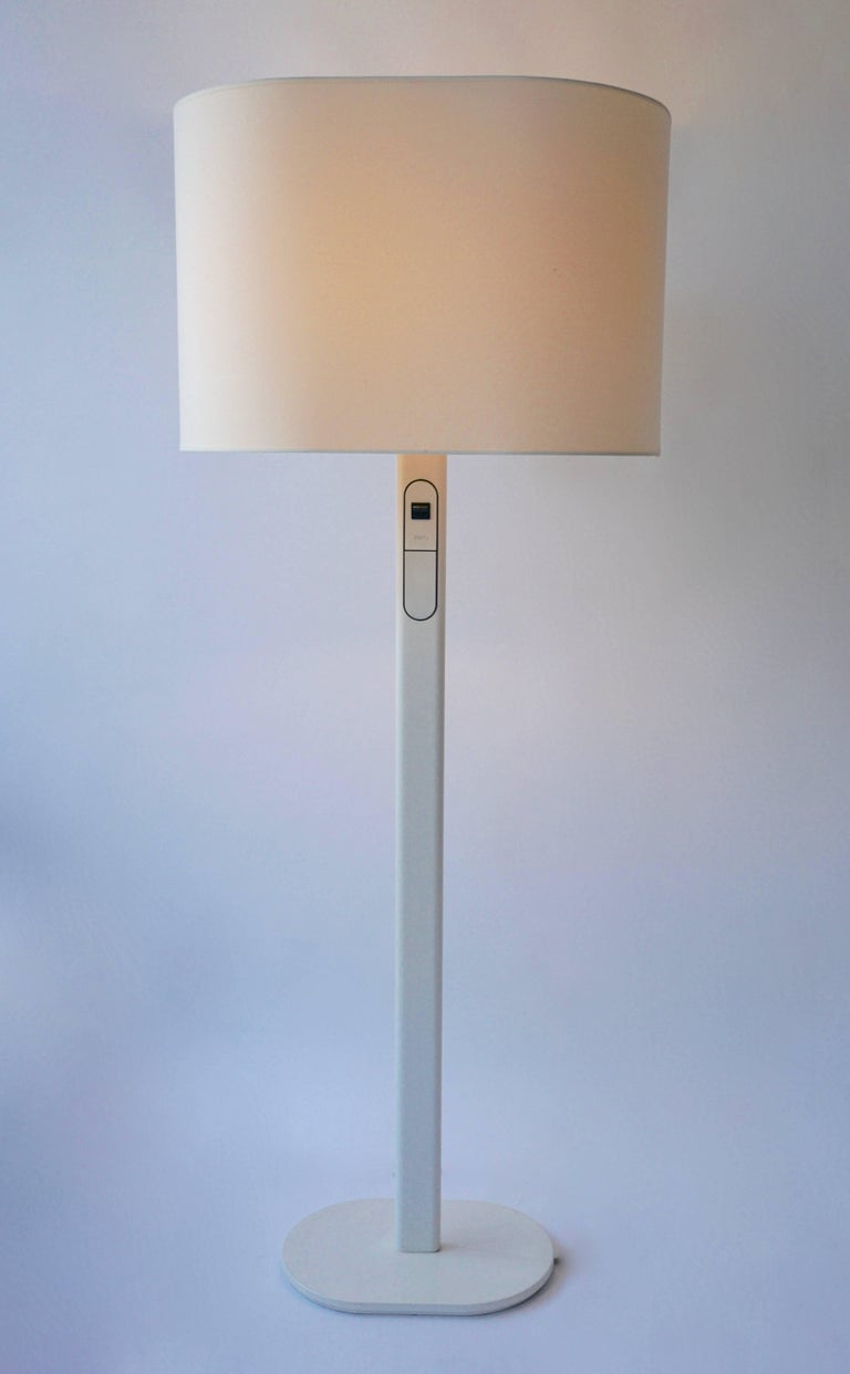 Rare floor lamp by Staff, Germany. The dimmer is built into the lamp and the top lamp can be dimmed separately. An uncommon functional form in fine vintage condition. Measures: Height 152 cm.  1980s staff floor lamp Materials: White powder