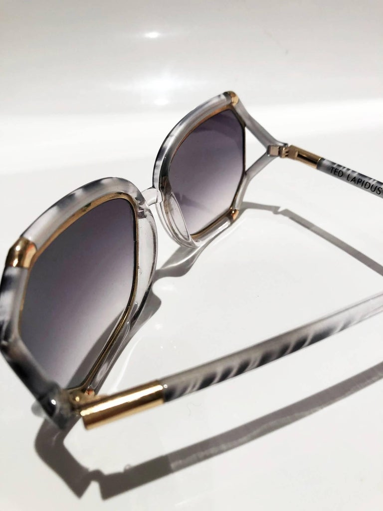 FREE UK and WORLDWIDE DELIVERY   Stunning and rare 1970s/1970s Ted Lapidus oversized sunglasses, grey, white transparent and gold ware around the eye ans on lens, blue/purple to clear gradient lens; glasses are stamped