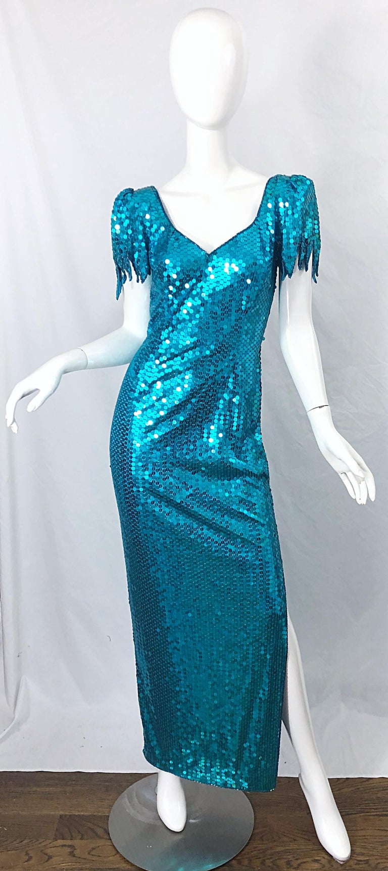 Avant Garde TED LAPIDUS turquoise blue fully sequined evening gown dress ! Features thousands of hand-sewn sequins throughout the entire dress. Hundreds of seed beads align the collar. Scalloped sleeve cuffs. Slit up the left side of the leg reveals