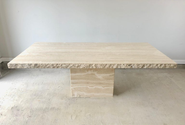 Massive Italian travertine dining table with sculpted live edge.