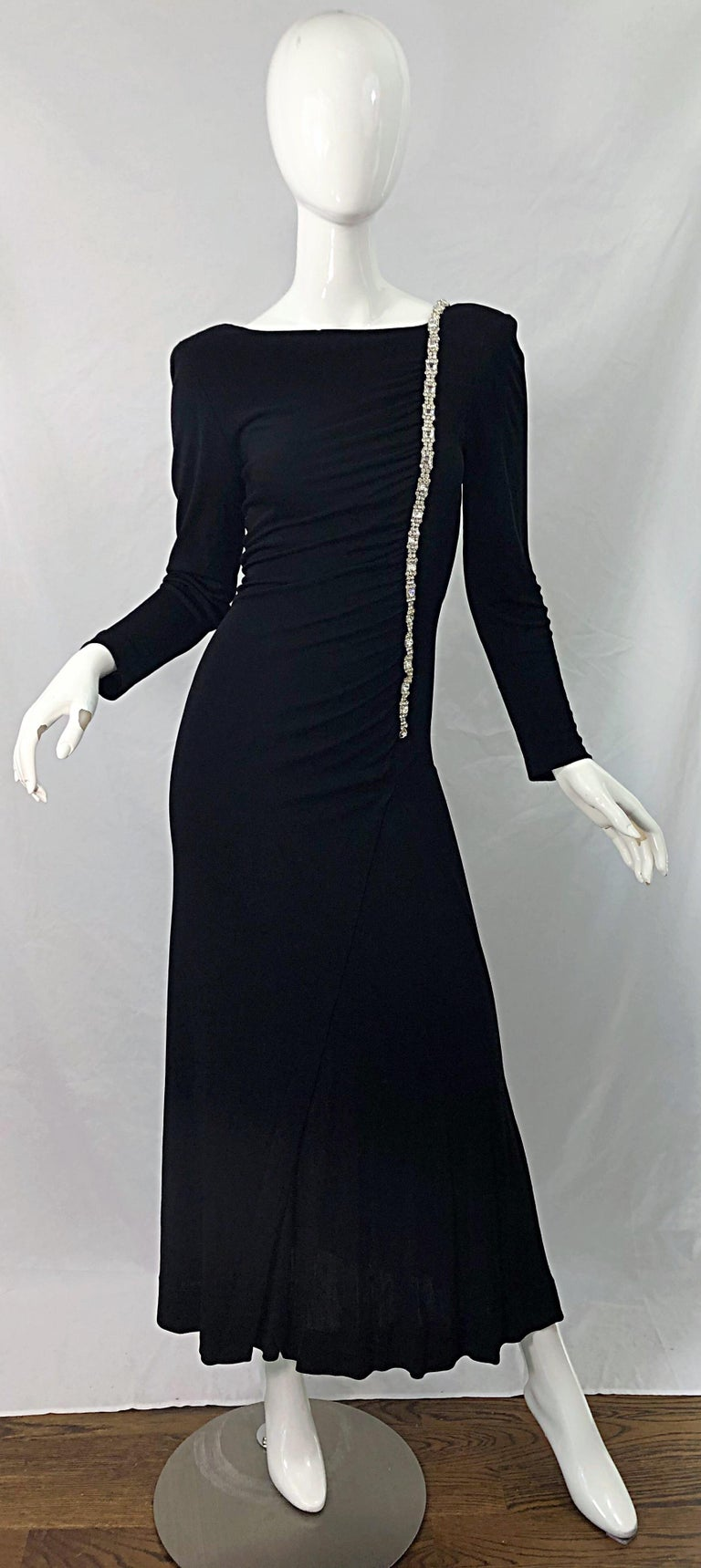 Beautiful and timeless WILLIAM TRAVILLA black matte silk jersey rhinestone encrusted long sleeve evening gown ! Features flattering ruching throughout the bodice. Interior shoulder pads add just the right amount of volume. Rhinestones hand-sewn