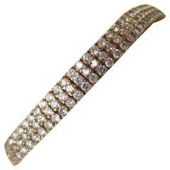 1980s Triple-Row Diamond Studded 14 Karat Yellow Gold Bracelet