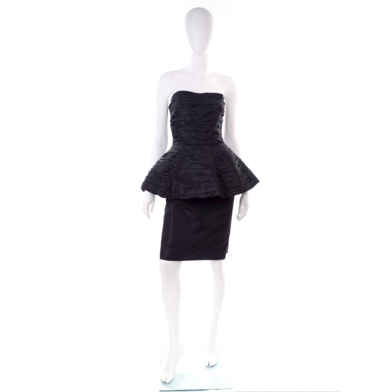This is an incredible vintage Victor Costa pleated strapless black evening dress with a fabulous peplum. This stunning vintage 1980's party dress has gorgeous pleating and closes with a back zipper and hook and eye.  We estimate this dress to fit a