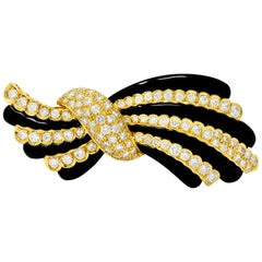 1980s Vintage 5.55 Carat Diamond Onyx 18 Karat Gold Striped Bow Brooch