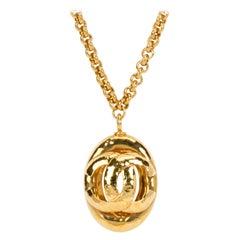 1980's Vintage Chanel Large Oval CC Logo Pendant Gold Necklace