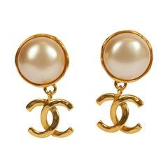 1980's Vintage Chanel Pearl CC Logo Gold Drop Earrings