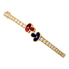 1980s Vintage French 1.05 Carat Ruby 2.16 Carat Diamond and Sapphire Gold Bangle