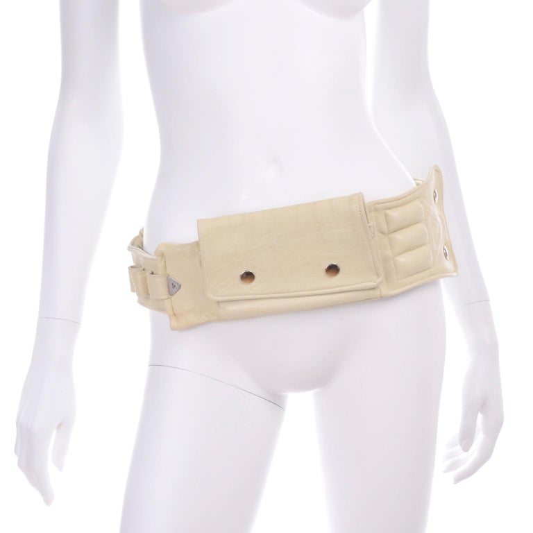 This gorgeous creamy lambskin leather belt can carry everything you need for a night out!  It has one big fold over pocket with one compartment inside and out, and 3 loops for a make-up brush or lipstick. Scovill style snap closures.  This belt came