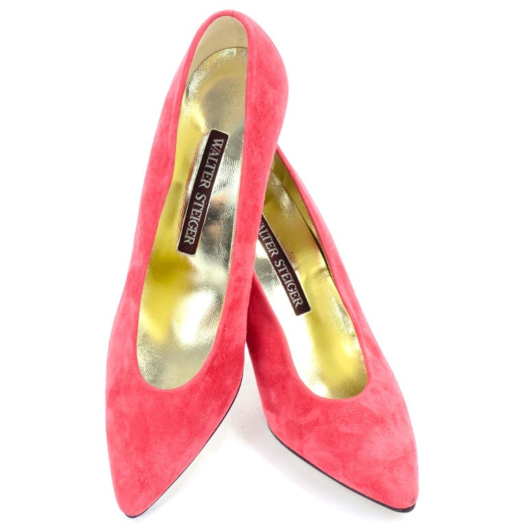 These are incredible vintage Walter Steiger shoes in a pinkish salmon or pink coral suede.  The heel bows out in the back and is made in a reflective silver metal similar to a mirror. Worn maybe once, if at all. Made in Italy, size 7AA.  BALL WIDTH: