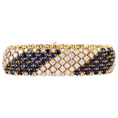 1980s Wide 36.28 Carat Diamond and Sapphire 18 Karat Bracelet
