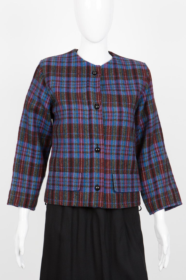1980s Yves Saint Laurent check wool jacket featuring a blue multico check pattern, a round collar. 100% wool In excellent vintage condition. Made in France.  Label size: 34fr 36fr/ US4/ UK8 We guarantee you will receive this gorgeous item as