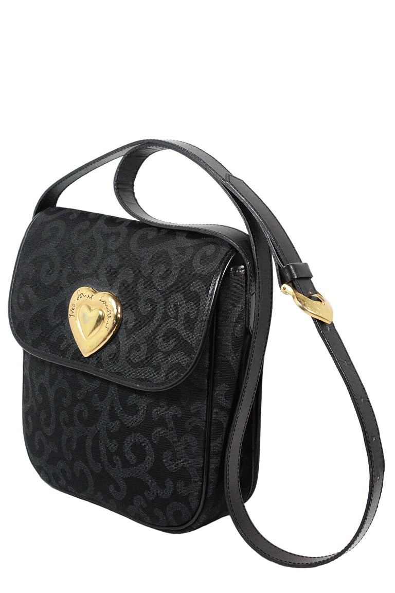 1980s canvas handbag Gold heart hardware  Black swirl print fabric  Black leather strap Gold buckle  Interior leather pocket  Made in France by Yves Saint Laurent