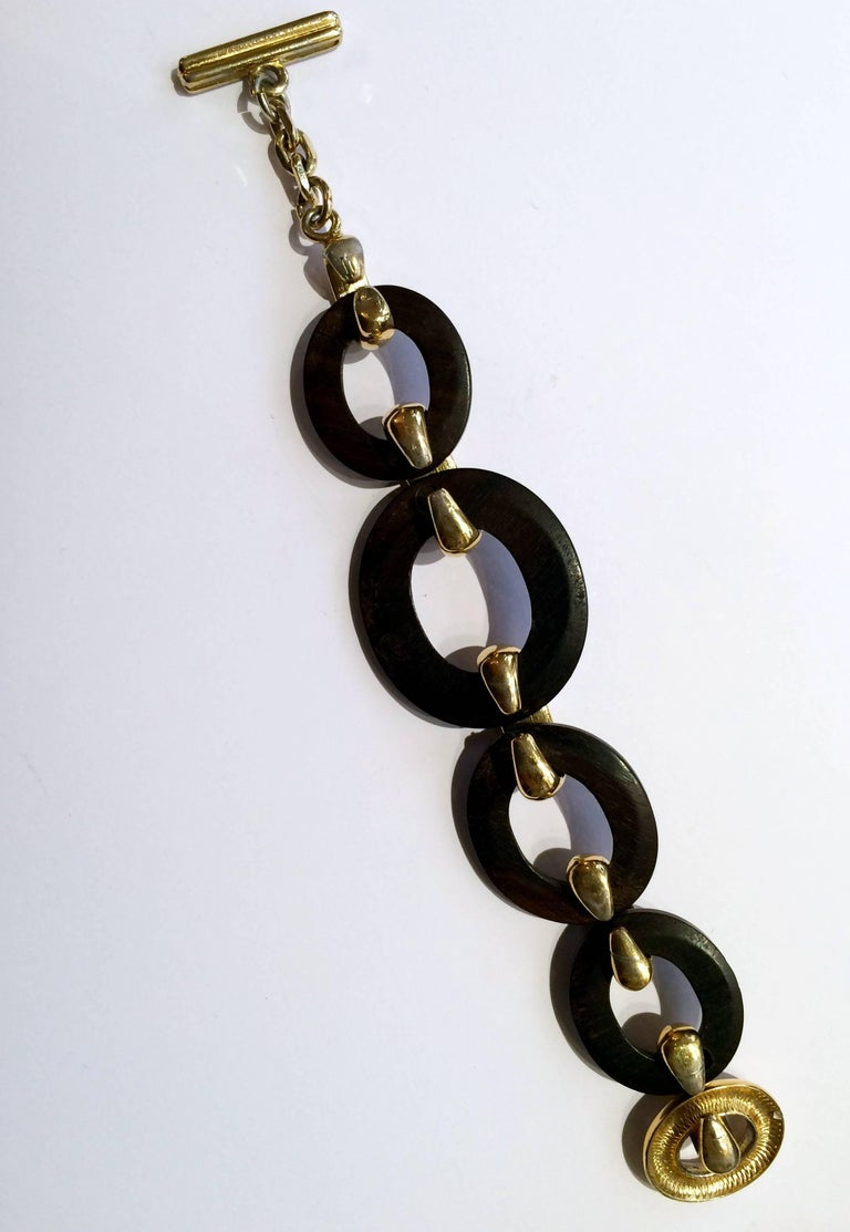 1980s Yves Saint Laurent gold tone chain with black resine beads featuring a toggle closure with embossed YSL on. Length 7,4in. (19cm) In excellent vintage condition.  Made in France. We guarantee you will receive this gorgeous earrings as described