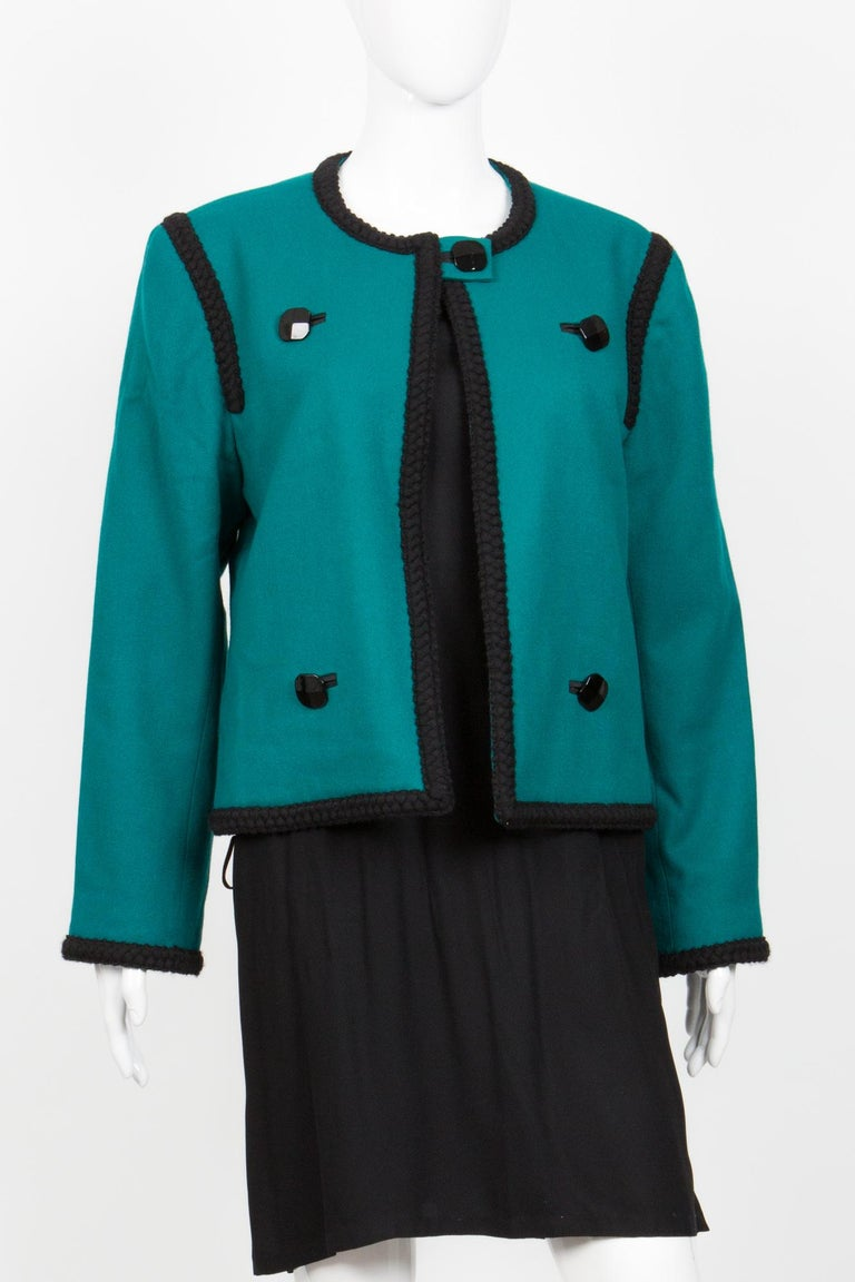 1980s Yves Saint Laurent emerald green wool jacket featuring a black braided finishing, black decorative buttons. 100% wool In excellent vintage condition. Made in France.  Estimated size 40fr/US8/UK12 We guarantee you will receive this gorgeous