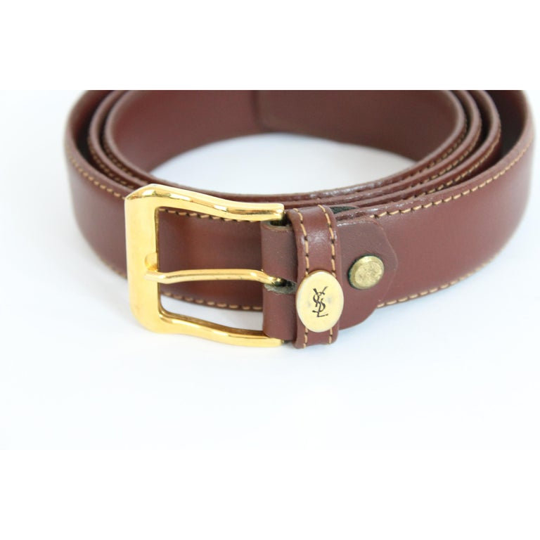 Yves Saint Laurent brown belt vintage gold plated bucke , 100% leather. Made in Italy. Excellent vintage condition.  Lenght: 130 cm Large: 3 cm