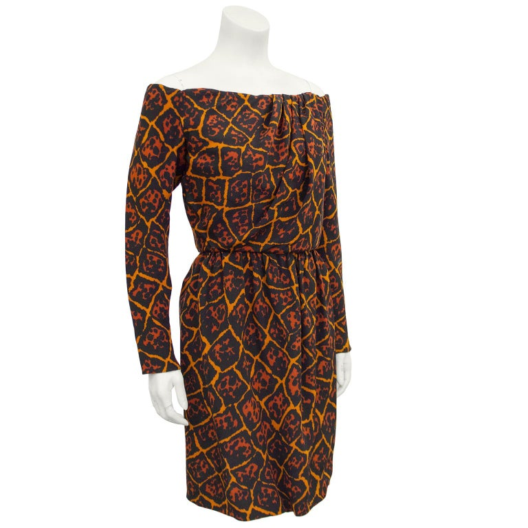 Yves Saint Laurent early 1980s orange, black and brick color allover leopard/giraffe fusion print crepe dress. Interior boning and corset with snap closures on left side when wearing. Off the shoulder & long sleeves with zippers at cuffs. Ruching