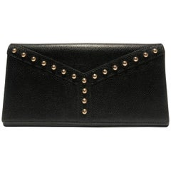 1980s Yves Saint Laurent stud wallet purse