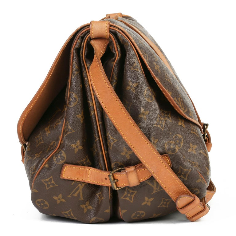 LOUIS VUITTON Brown Monogram Coated Canvas Vintage Samur 356  Xupes Reference: HB3778 Serial Number: 881.V.I Age (Circa): 1981 Authenticity Details: Date Stamp (Made in France)  Gender: Ladies Type: Shoulder, Crossbody   Colour: Brown Hardware: