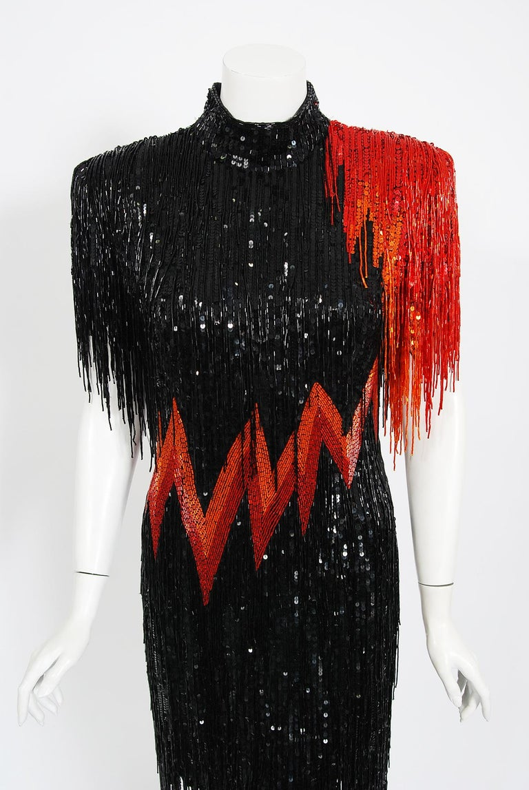 Fierce fully-beaded sequin Bob Mackie designer dress dating back to the early 1980's. Mackie began his career as a Hollywood costuming sketch artist, working for both Edith Head and Jean Louis. While working with designer Ray Aghayan, Mackie soon