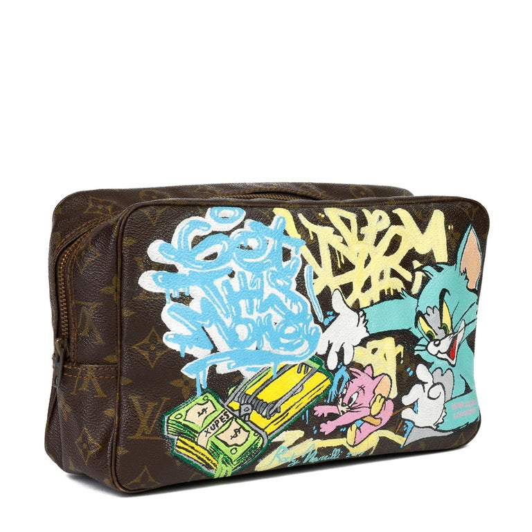 LOUIS VUITTON Hand-painted 'Get This Money' X Year Zero London Toiletry Pouch  Xupes Reference: CB327 Serial Number: 833 Age (Circa): 1983 Authenticity Details: Date Stamp (Made in France) Gender: Ladies Type: Travel, Accessory  Colour: Multi