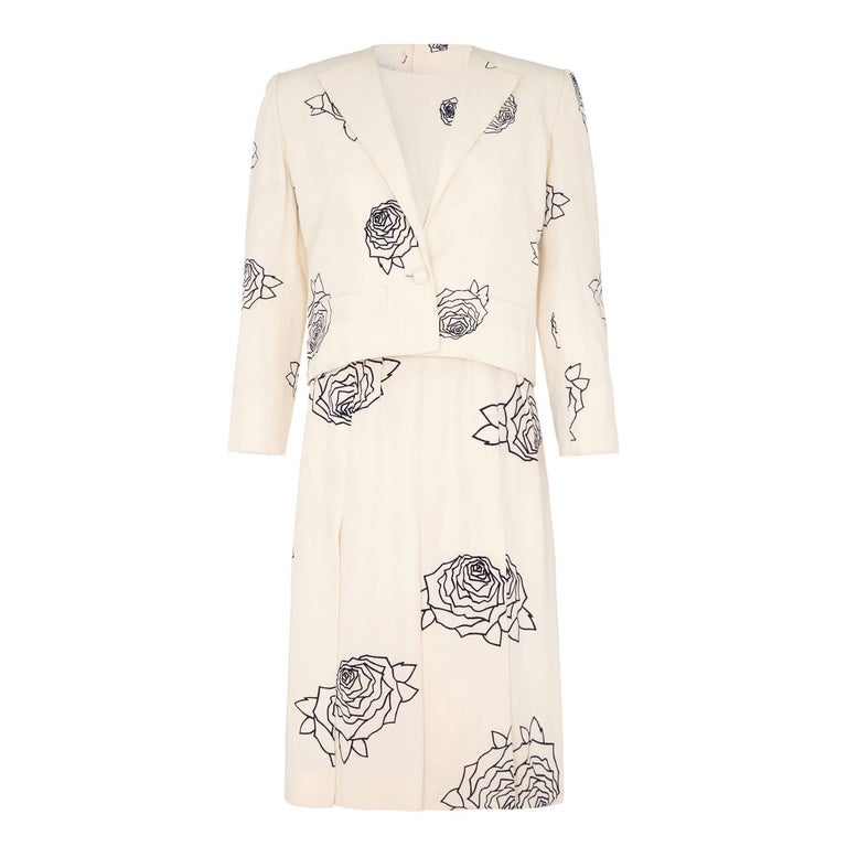 Outstanding labelled and numbered 19816 spring/summer 1984 Christian Dior haute couture dress suit designed by Marc Bohan. The dress is entirely handmade in printed ivory silk and is fully lined in a silk lining throughout. Comprising of a