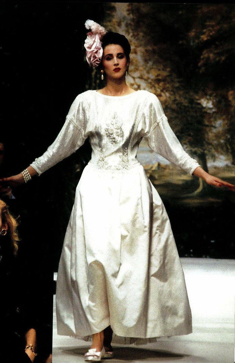 Chanel is known to be one of the most luxurious and decadent fashion houses in the world. This breathtaking ivory-white formal gown, from head designer Karl Lagerfeld's 1985 collection, is a perfect example of why this couture brand has stood the