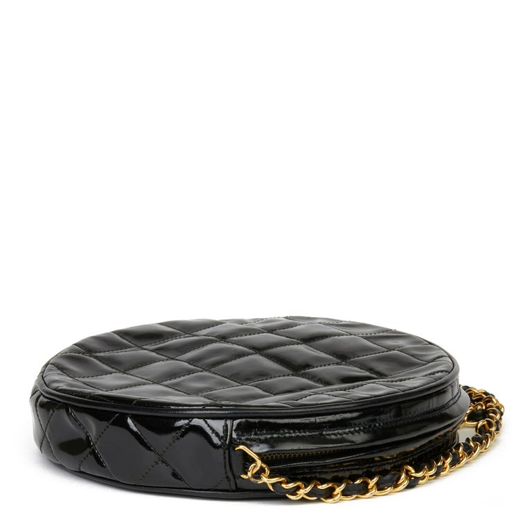CHANEL Black Patent Leather Vintage Round Fringe Shoulder Bag  Xupes Reference: HB3401 Serial Number: 0406230 Age (Circa): 1986 Accompanied By: Chanel Dust Bag, Authenticity Card Authenticity Details: Authenticity Card, Serial Sticker (Made in