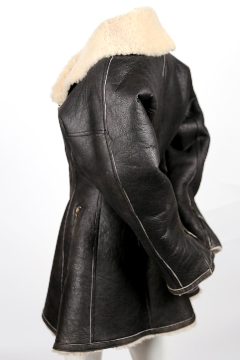 Brown shearling coat with flared hem designed by Azzedine Alaia dating to 1987. Coat is labeled a French 38. Measurements are difficult to take due to the thickness of the shearling. Measured from the outside, are the following approximate