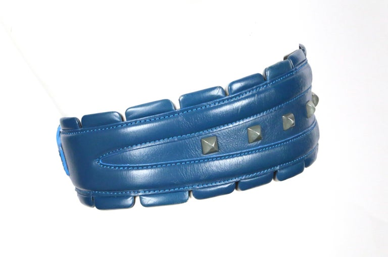 Very rare blue-green leather belt with gunmetal pyramid studs from Azzedine Alaia as seen on the fall 1988 runway. Belt is labeled a French 65 and ideally fits a 23-24.5