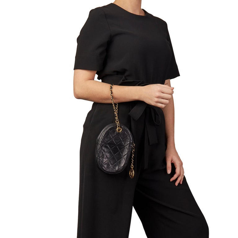 CHANEL Black Quilted Lambskin Vintage Timeless Charm Wristlet   Xupes Reference: HB3164 Serial Number: 0863644 Age (Circa): 1988 Accompanied By: Authenticity Card Authenticity Details: Serial Sticker, Authenticity Card (Made in Italy) Gender: