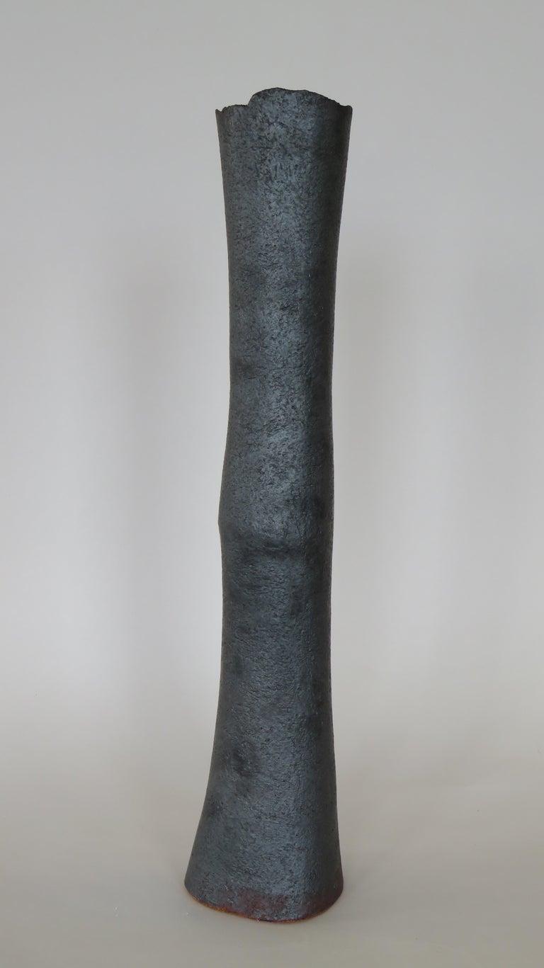 North American Tubular Metallic Black Stoneware Vase, Rough Fluted Rim For Sale